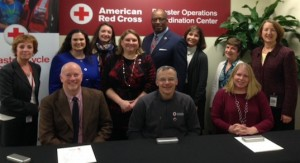 CRCC managing director Brie Loskota (far right) participates in a signing ceremony at the American Red Cross Disaster Operations Center.