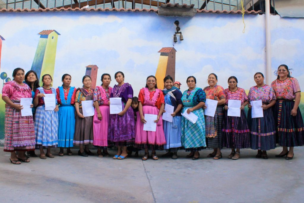 Señoras with their basic literacy diplomas